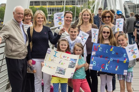 """""""Go Team Quad"""" Family & Friends on Golden Jubilee bridge waiting to cheer the riders on."""