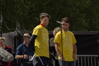 Jon Butterworth addresses the crowd gathered in Horse Guards Parade. Mark Cavendish looks on.