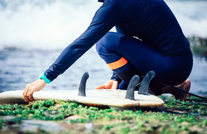 Women With Surfboard And Blue Watch