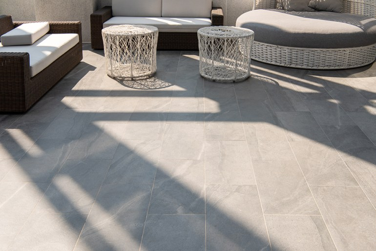 Grey garden tiles. Rattan garden furniture