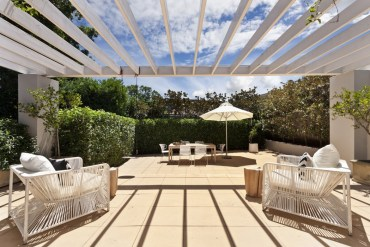 Sunny Garden With Garden Furniture And White Pergola