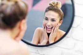 Women looking in mirror