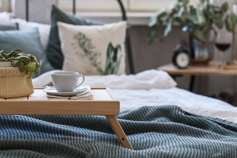 Cosy bed with coffee cup on tray