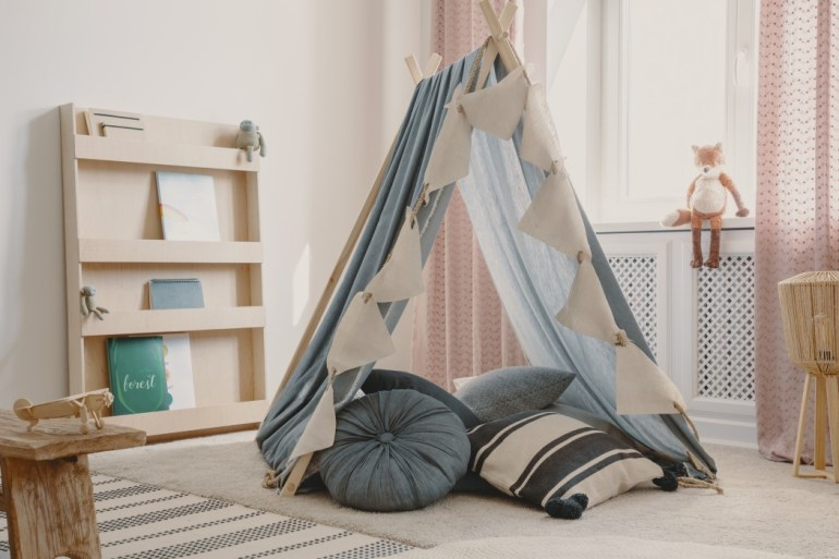 Tnt with pillows in natural scandinavian playroom for kids
