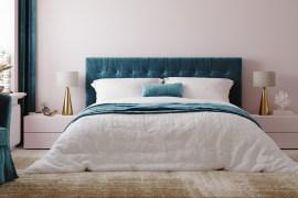 Luxury bedroom with rich blue headboard