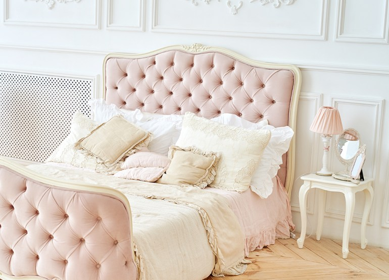 Romantic bedroom with pink ornate bed