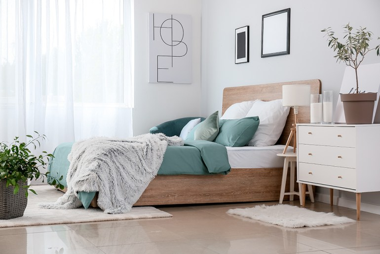 Modern bedroom with large wooden bed