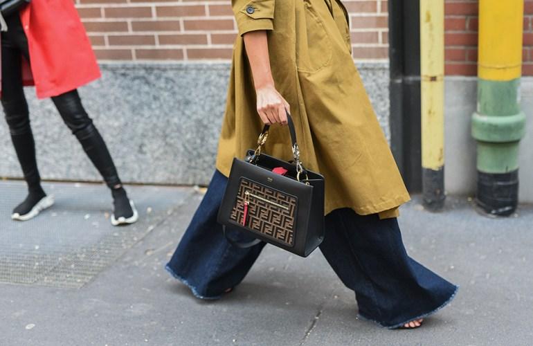 Milan, Italy - Fashionable woman wearing Fendi outfit and handbag