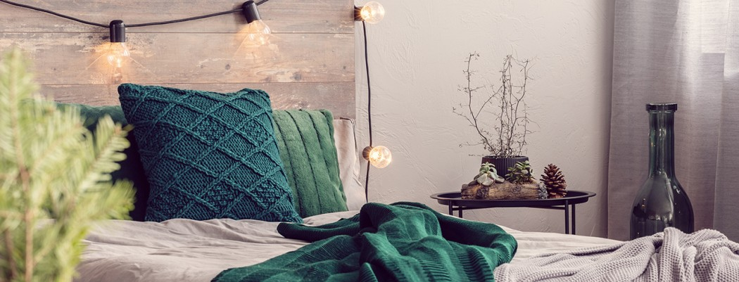 Cosy bedroom with Green accessories and festoon lighting