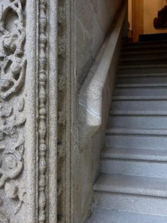 Carved granite stair rail