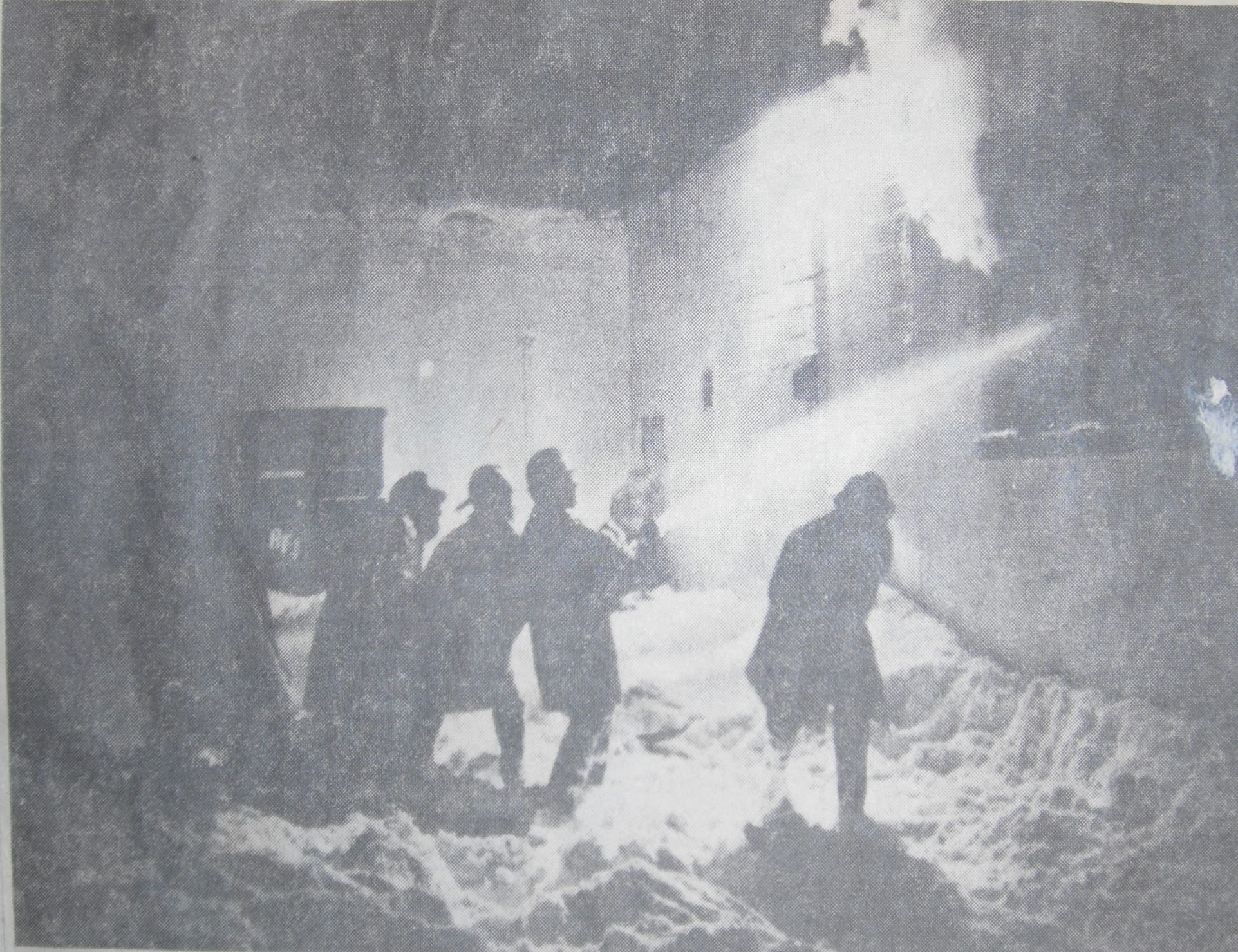 Firemen waded through knee-deep snow to fight a blaze