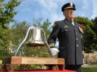 Retired Deputy Fire Chief Peter Harding sounds the Fire Service Bell in memory of those fallen members of the London Fire Department.
