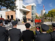 Fire fighters pay tribute to their fallen comrades at the Fire Fighter Day of Remembrance in front of the London Fire Department Memorial Headquarters on Tuesday morning (Sept. 11).