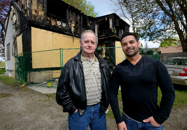 Londoners Doug O'Loughlin, left, and Adam Mortezof stand outside a neighbours home which was destroyed by fire on April 30, 2016. The two men will receive a Citizen Involvement Award from the London Fire Department for their efforts getting family members out of the house during the blaze. (MORRIS LAMONT, The London Free Press)