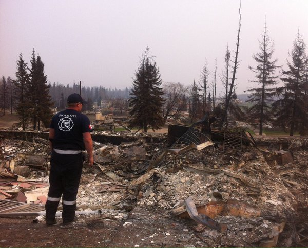Firefighter Randy Evans surveys the damage in Fort McMurray