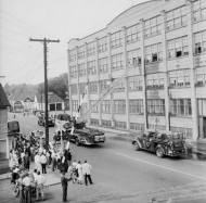 Firefighters respond to Murray-Selby Shoe factory on Richmond Street after a sprinkler had burst. This view is looking north from CPR tracks and a gas station can be seen at the corner of Richmond and Piccadilly streets August 1954 Western Archives, LFP negative collection via historypin.org
