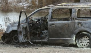 The burned out remains of a van in a parking lot at Riverside Drive and Wonderland Road on Friday January 27, 2017. MORRIS LAMONT/THE LONDON FREE PRESS /POSTMEDIA NETWORK