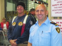 Two fire fighters taking a moment to pose for a photo at the annual MD Boot Toll
