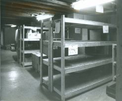 Empty shelves in the basement of the London and Area Food Bank at 772 Dundas Street. (March 1990)