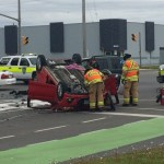 3 vehicle crash sends car onto its roof