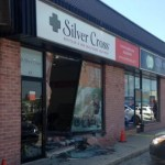Car crashes into front window of northwest business