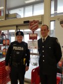 London Police ONVerified account @lpsmediaoffice Dec 13 A photo of S/Sgt Harvey & Firefighter Bell at today's 911 Christmas Kettle Day here in #ldnont. Active and retired members of @MLPS911 @LPFFA @OPP_WR @RCMPONT and LPS are volunteering their time around 35 locations in support of @TSALondon. Come on out & help fill the kettles!