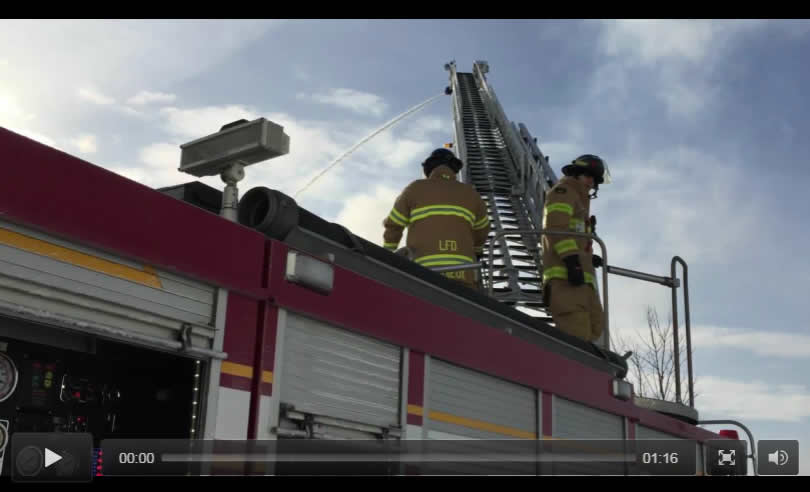 Firefighters on ladder truck