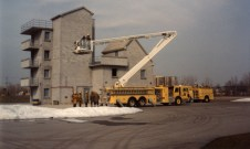 """The '85 boom from the '72 Ford/KS was remounted on this 1985 King CM1 chassis with all new body. I took this photo at the drill tower as it was doing some training with Eng 4's crew just before it was put into service. This truck was one of the last out of the KingSeagrave plant before it closed its doors for good. """"It was in my opinion, one of the nicest looking rigs London ever had."""" - R. Loiselle"""