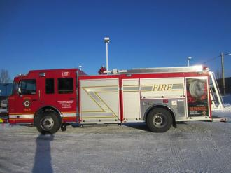Driver's side view of new Carl-Thibault rescue pumper
