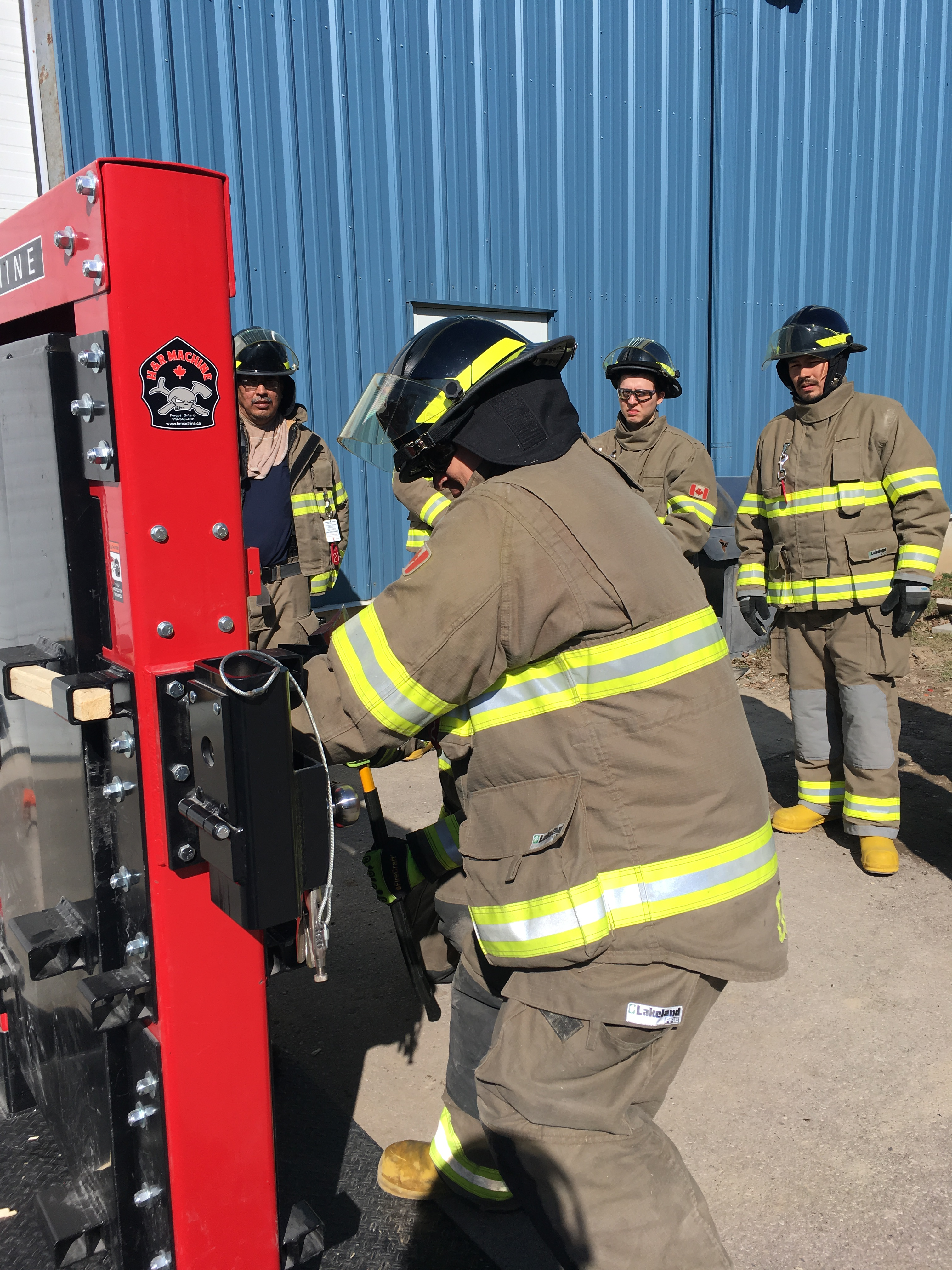 Fire fighters training to force open a door