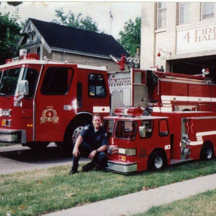 Firefighter Tim Knight posing with Engine