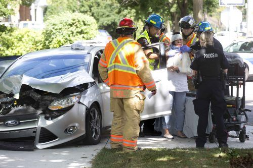 Fire fighters and paramedics assist injured drivers