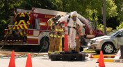 London police and firefighters are decontaminated after leaving a suspected drug lab in a townhouse complex on Hamilton Road near Gore Road, Wednesday June 12, 2019. (Max Martin/The London Free Press)