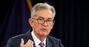 Federal Reserve Chairman Jerome Powell; interest rates cut for the first time in a decade.