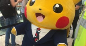 Pikachu mascot stands outside the pokemon london centre