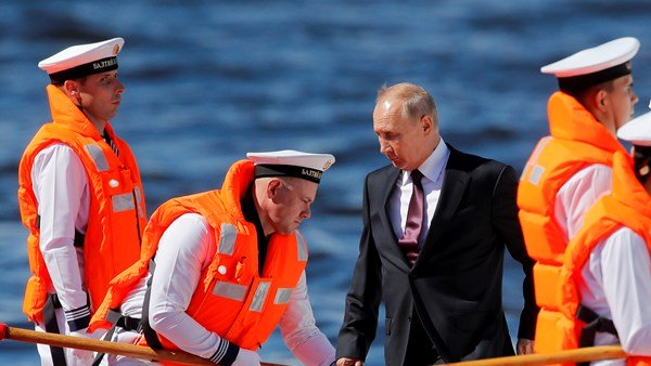 Vladimir Putin attends naval parade of new ships