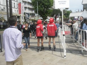 Even the local paper does promo stunts: red girls on rollerskates