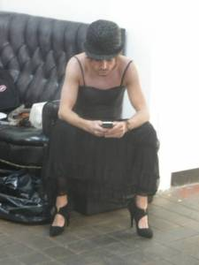 Dress, bowler hat, iPhone. Why not? Pic: D Wells