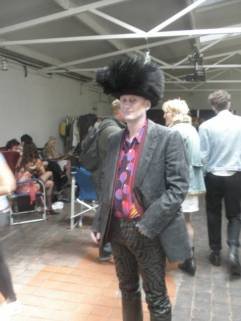 Me, as Music Industry Type, with Noel Fielding just behind. Alexander McQueen trousers and purple space shirt my own