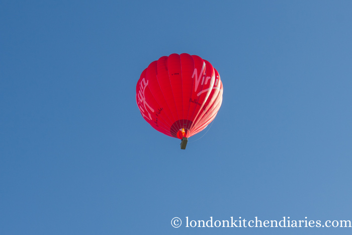 Virgin red hot air balloon in blue sky
