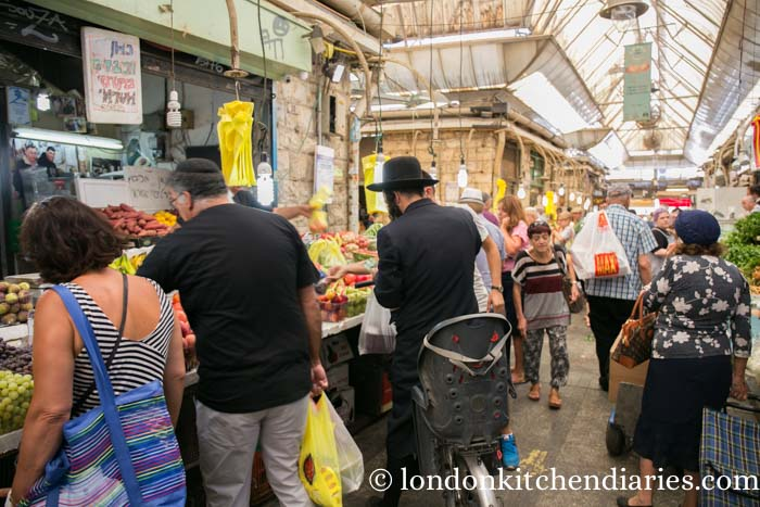 Locals shopping at Methane Yehudi Market Jerusalem