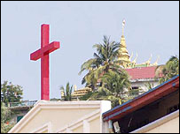 Christianity and Buddhism share the skyline in Sihanoukville - from BBC website