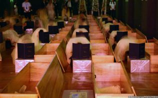 Participants enter a death experience room where they choose a coffin and put on a death robe