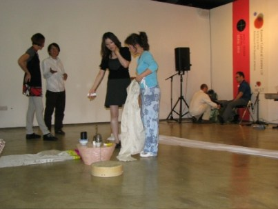 Sunnee Lee and Nam-hee Kim discuss the Shamanistic altar (photo: Seong Hee Jo)