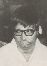 Suh Sung at his trial in 1972, bearing the scars of a failed suicide attempt