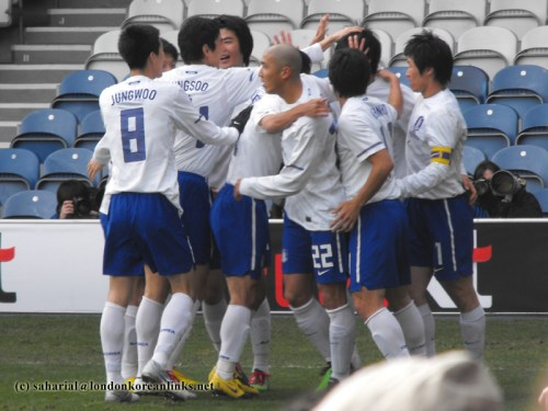 The Korean team celebrate after the first goal