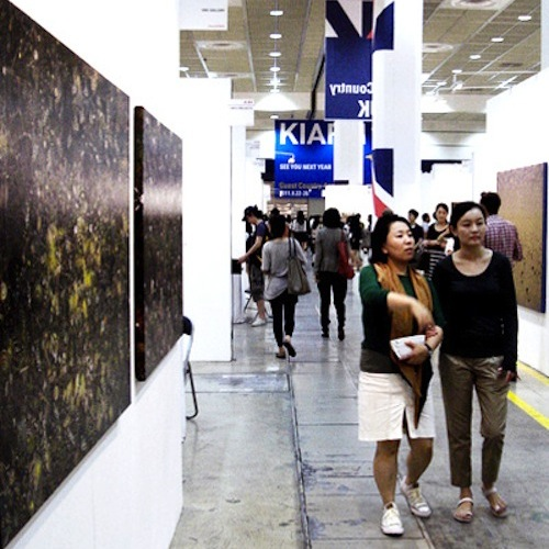 Visitors stroll through the corridor of British galleries at COEX