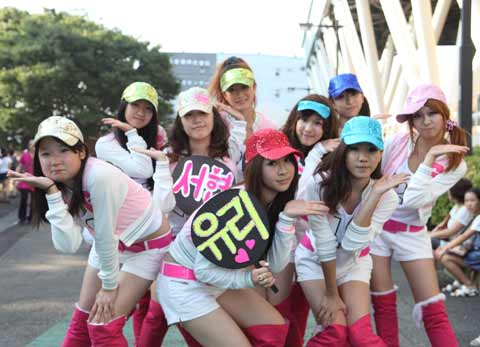 Japanese cosplayers pose as Girls Generation