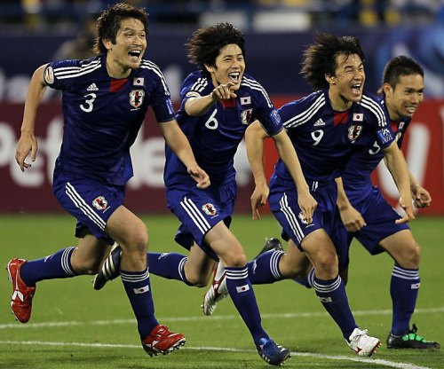 The Japanese team celebrates victory