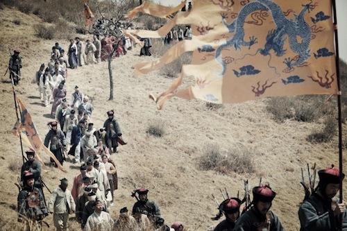 Korean prisoners are herded towards the Manchurian border
